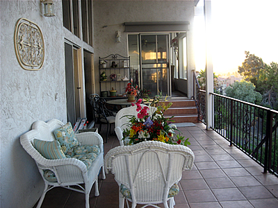 balcony with chairs and table